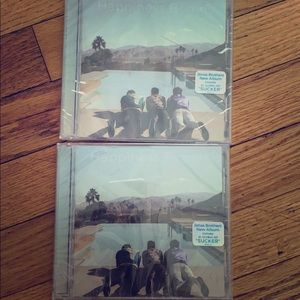 "Jonas Brothers ""Happiness Begins"" CDs."